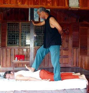 Bhagavan Shanmukha giving an Ayurvedic Massage